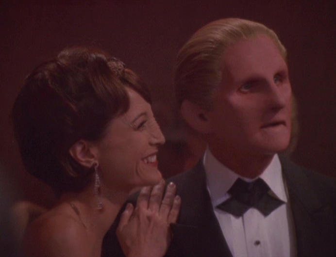 Kira whispers in Odo's ear