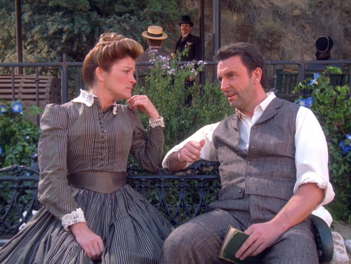 Janeway sits with Michael Sullivan