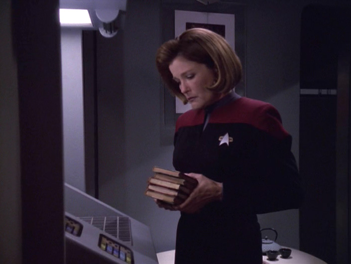 Janeway looks sadly down