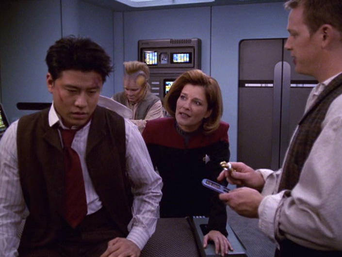 Janeway talks to an injured Kim
