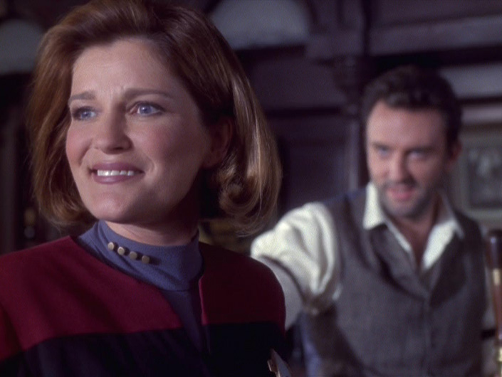 Janeway smiling with Michael in the background