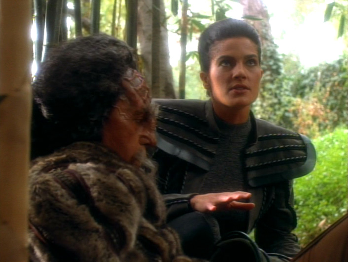 Jadzia and Kang outside the compound
