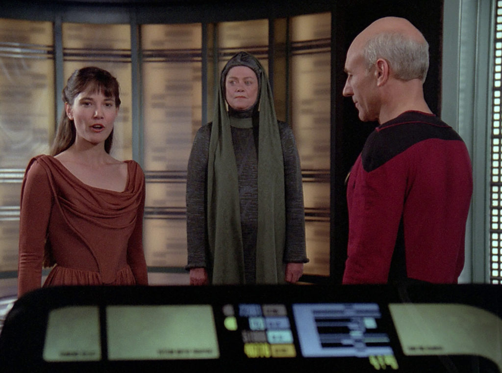 Salia and Anya arrive and greet Picard in the transporter room