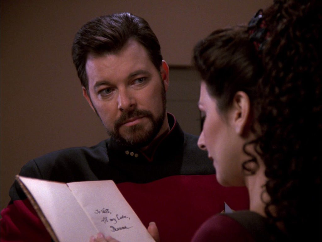 Troi reads the dedication in the book of poetry she gave to Will