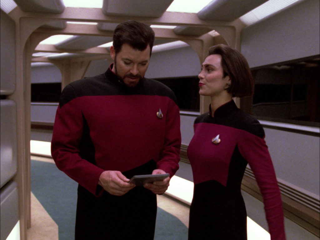 Ro flirts with Riker in the corridor