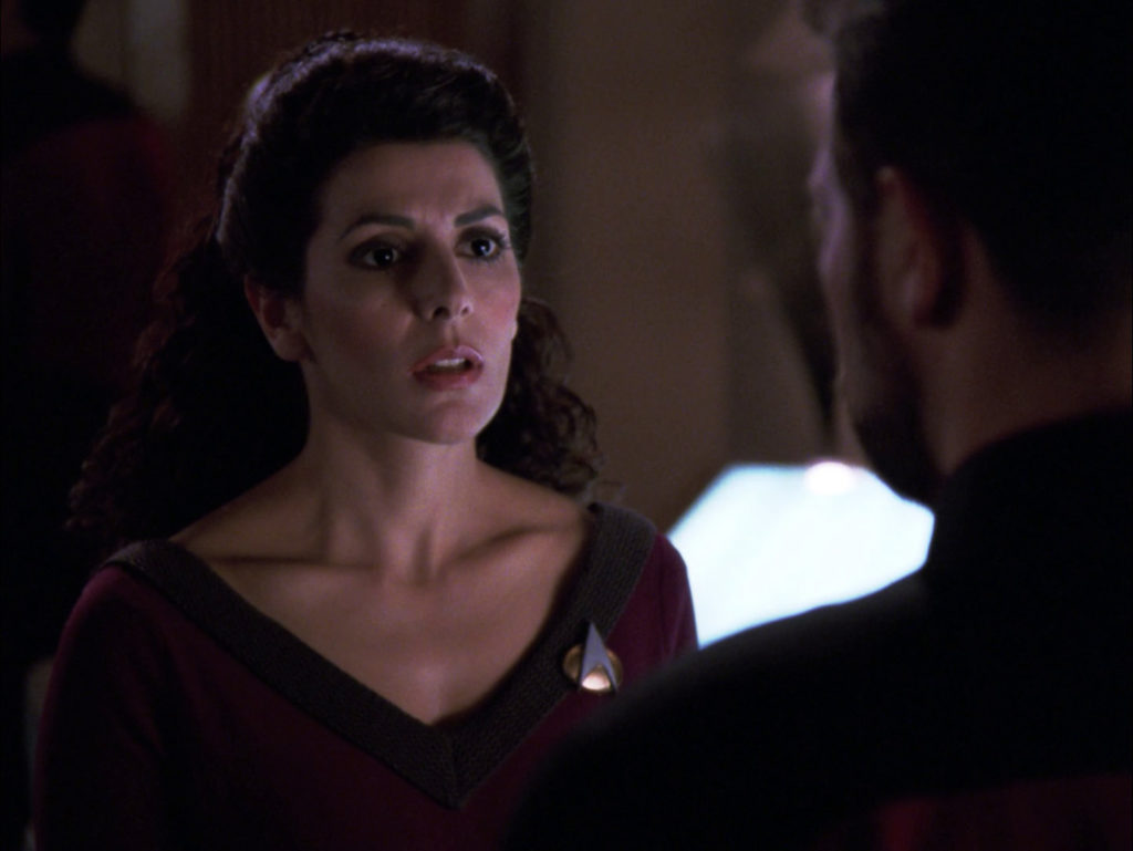 Troi stares at Riker with recognition