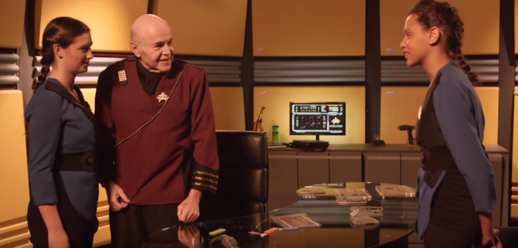 Chekov with his great-great granddaughter and her roomie in his office