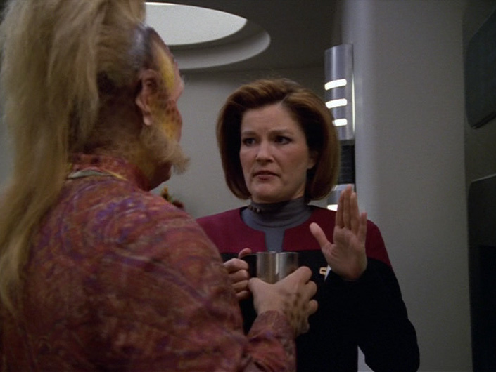 Janeway holds her hand up to stop Neelix talking before coffee