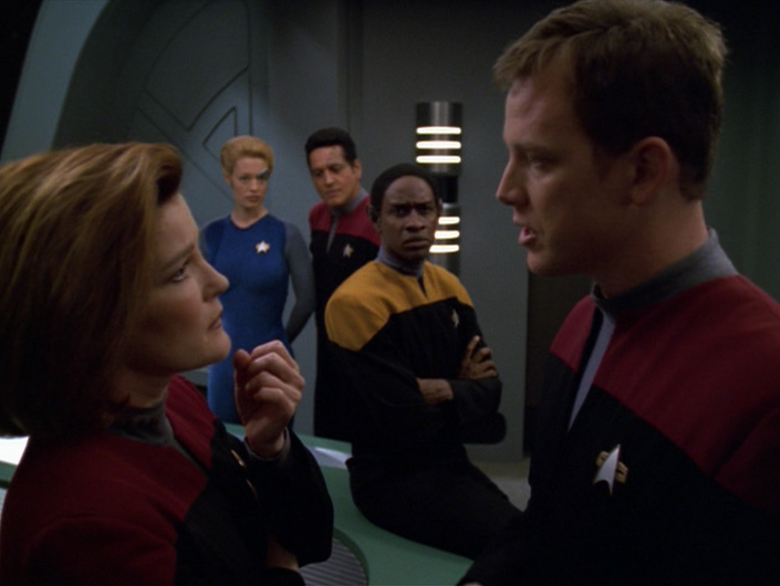 Janeway talks to Paris in the briefing room