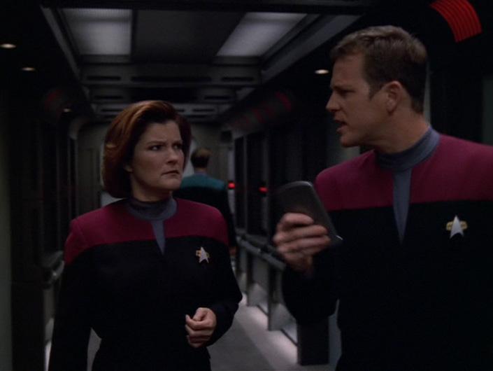 Janeway looks skeptically at Paris