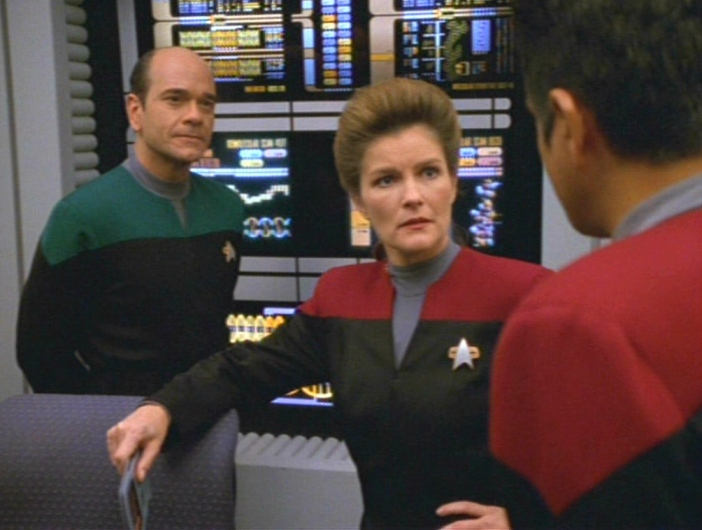 The Doctor, Janeway and Chakotay discuss the problem