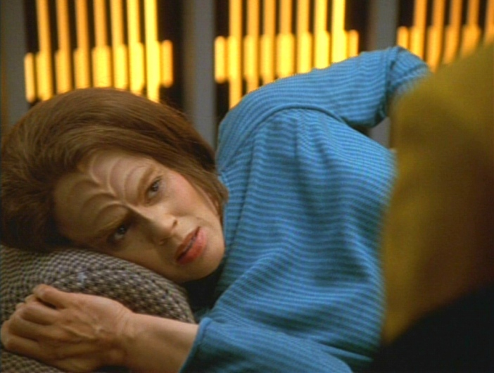 B'Elanna lying under a blanket in sickbay