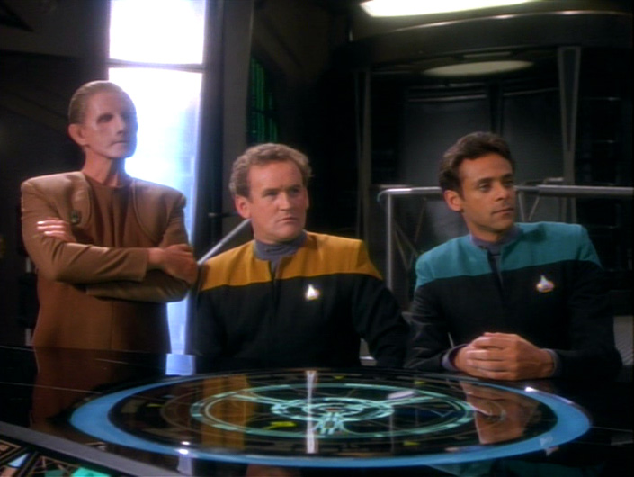 Odo, Miles and Bashir look offended