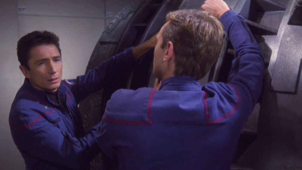 Trip and Tucker work on the pod