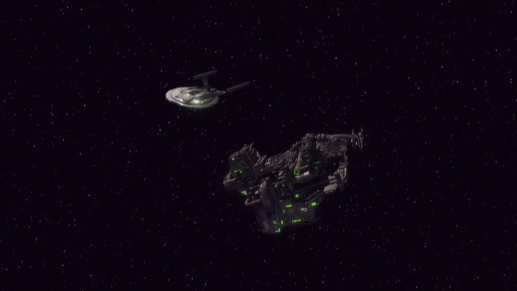 Assimilated transport ship floating off the bow of Enterprise