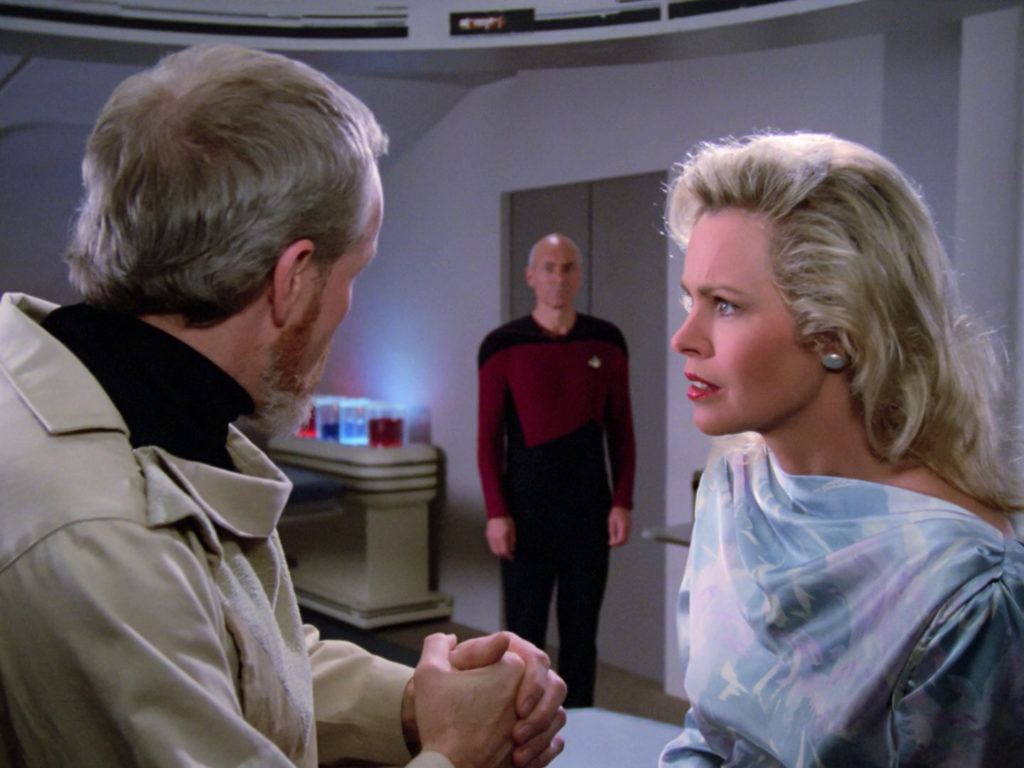 Dr. Manheim and Jenice Manheim talking in the lab when Picard walks in