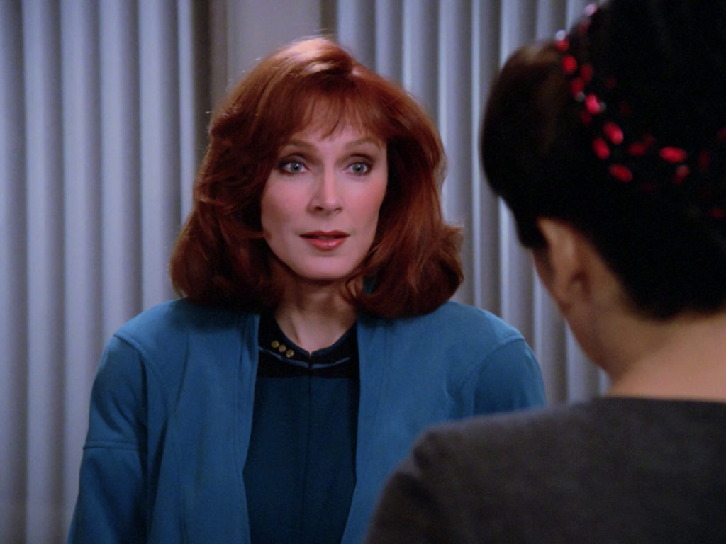 Dr. Crusher speaks with Troi