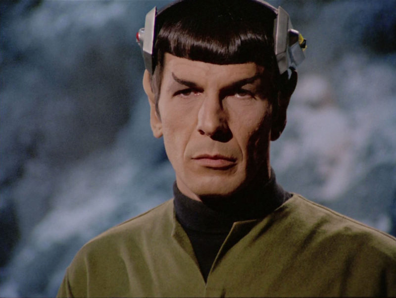 Spock with the electronic device on his head controlling his movements