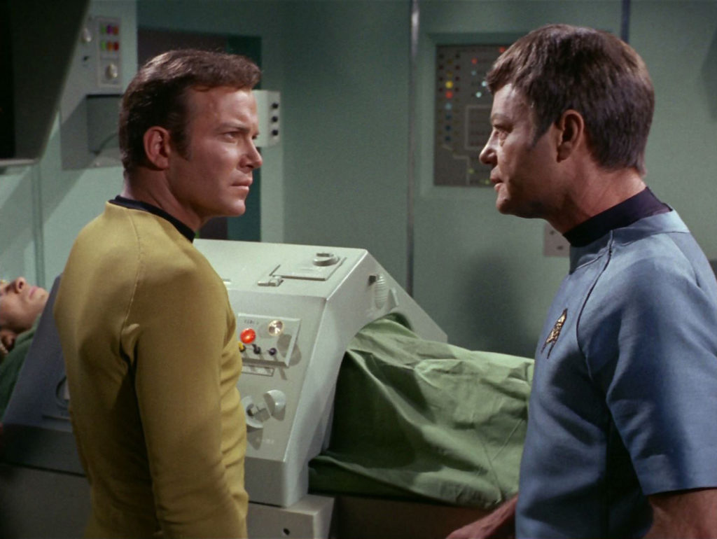 Kirk and McCoy discuss Spock's condition in Sickbay