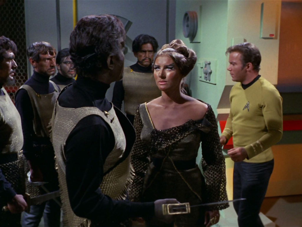 Mara pleads with Kang in front of his men