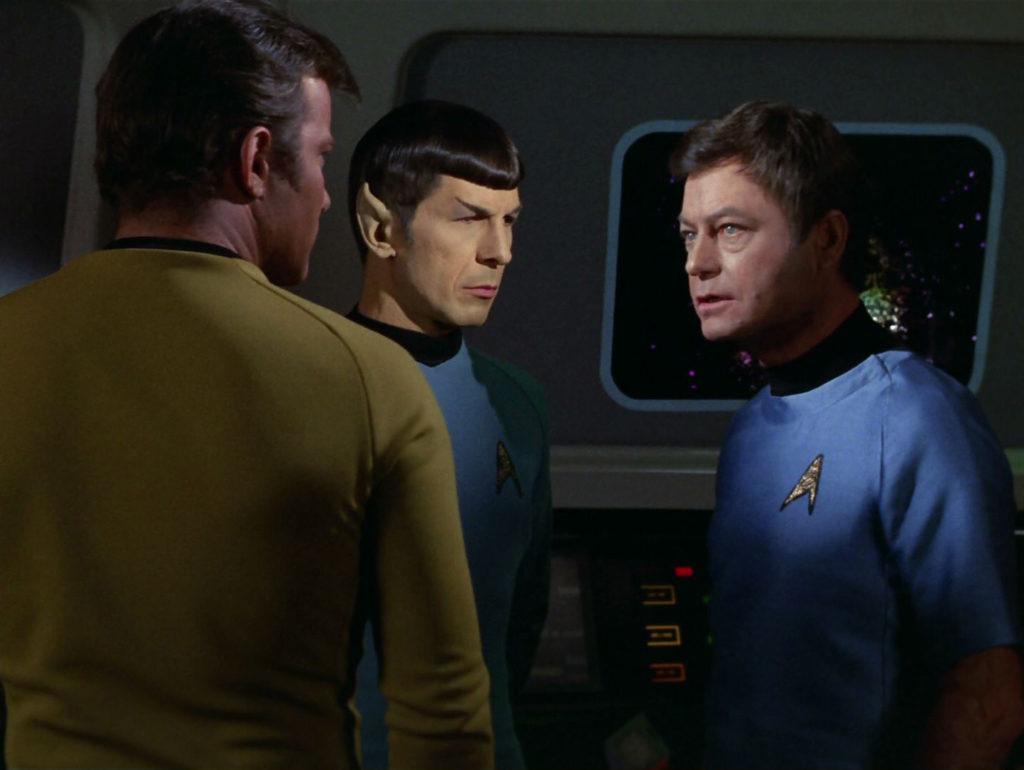 Kirk, Spock and McCoy strategize