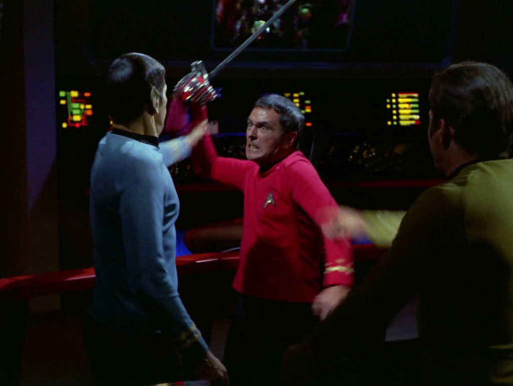 scotty comes at McCoy with a sword