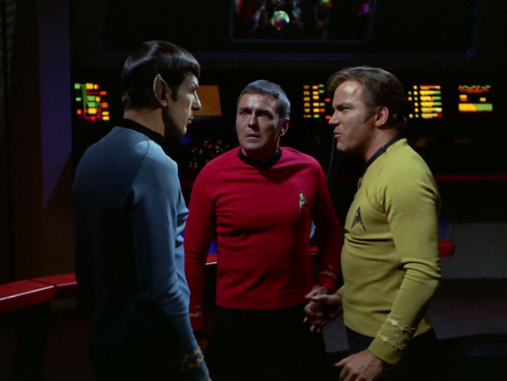 Spock, Scotty and McCoy on the bridge after the fight is over
