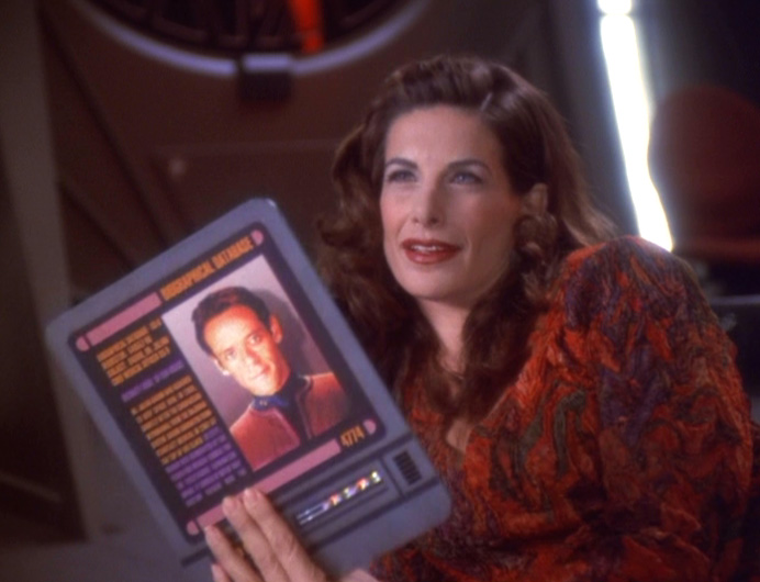 Lauren lounges sexily and shows Jack a PADD with a picture of Bashir on it