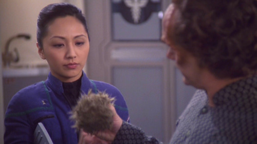 Hoshi looks at Phlox holding a tribble