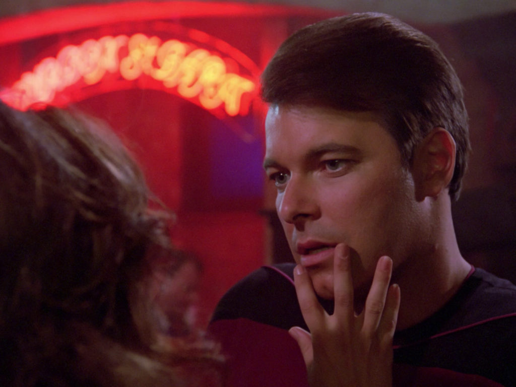 Minuet touches Riker's face