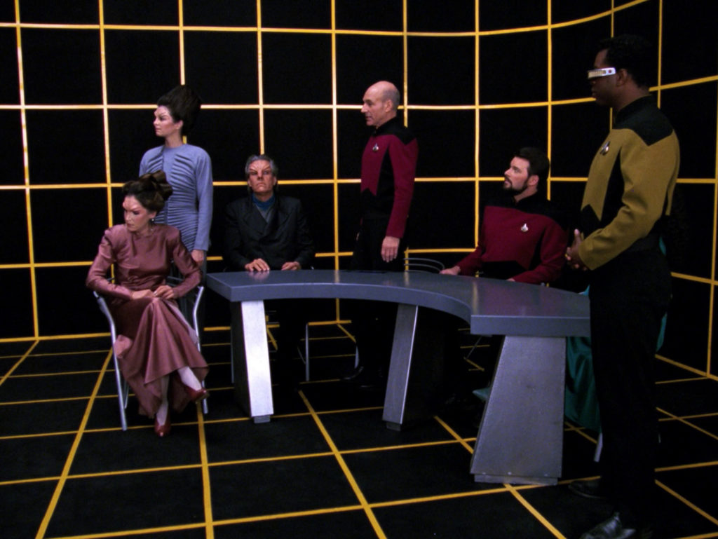 The characters at the hearing in the holodeck