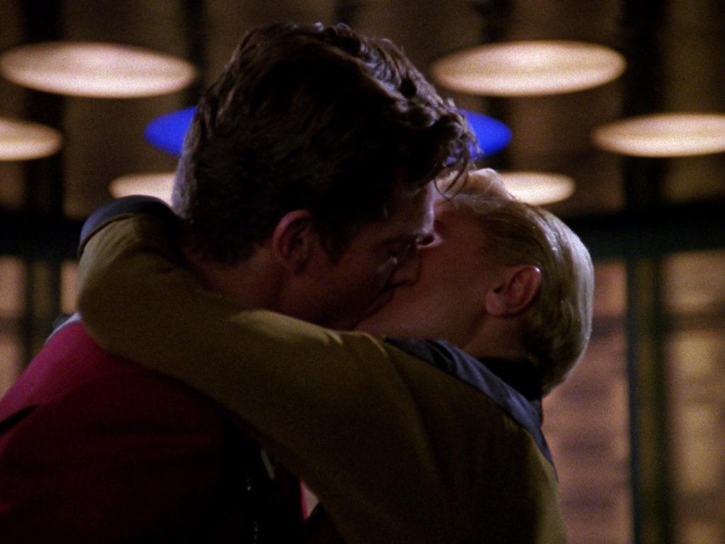Tasha kissing Castillo in the transporter room
