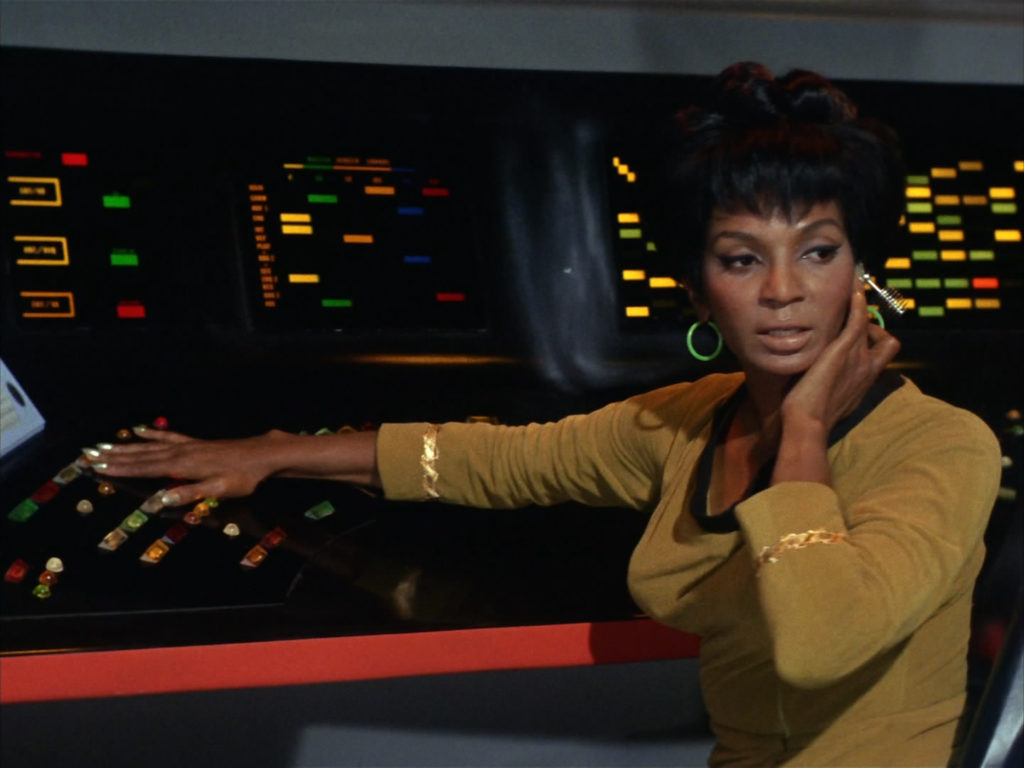 Uhura in her gold uniform at the comms station