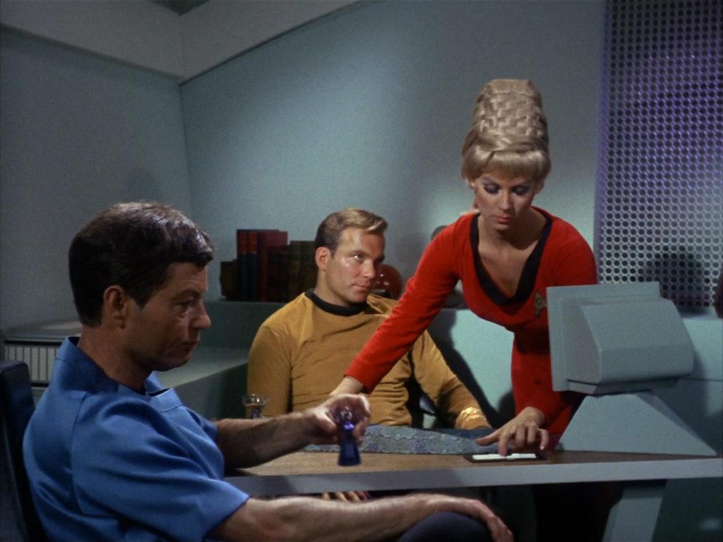 Rand brings Kirk dinner as he talks to McCoy