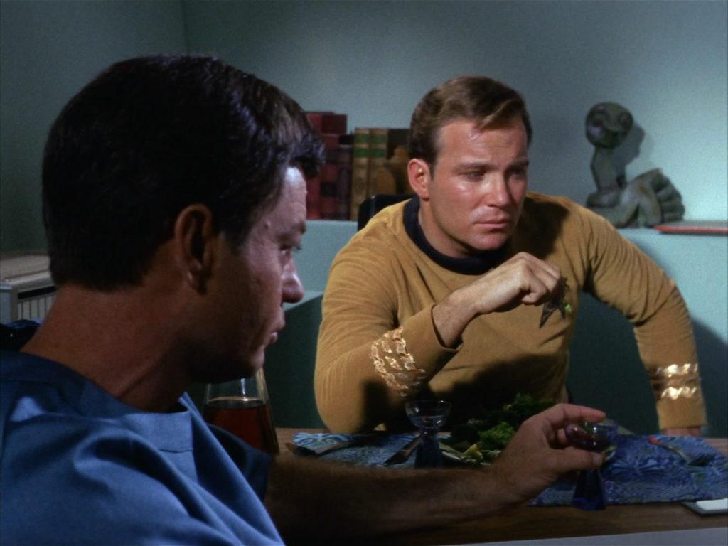 Kirk picks at his salad and complains to McCoy
