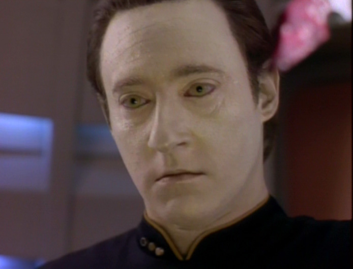 Data with a cold stare, holding the bloody knife