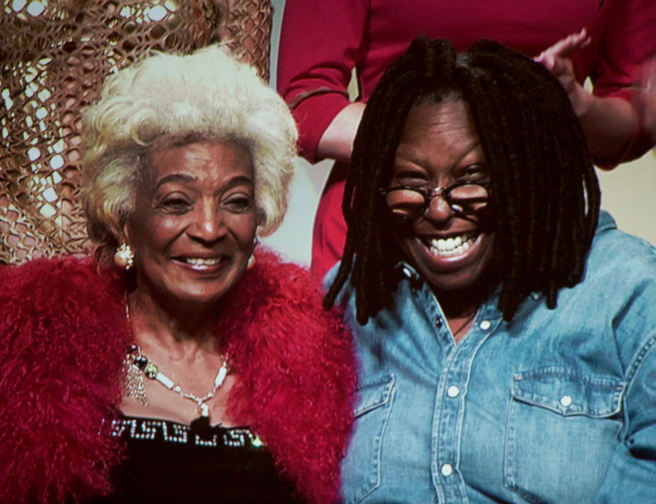 Nichelle Nichols and Whoopi Goldberg smiling on stage at STLV 2016