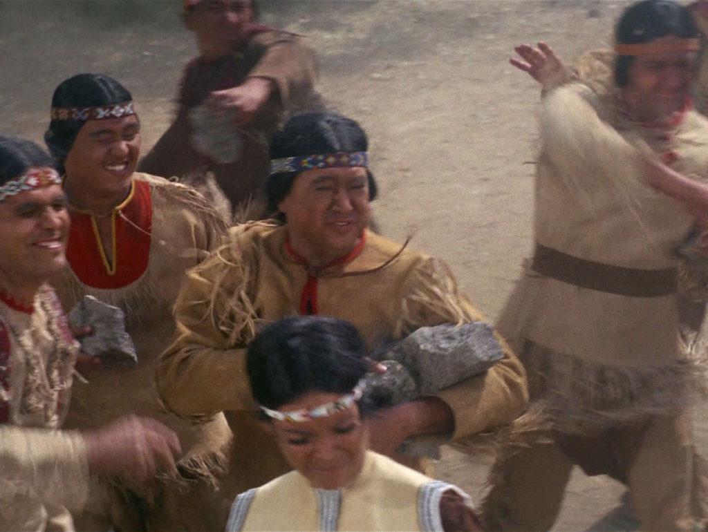 The mob stoning Kirk and Miramanee