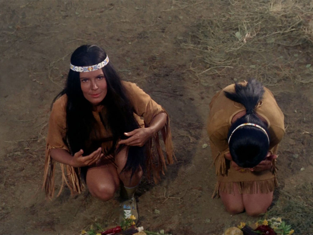 Miramanee and another Native woman bow to Kirk