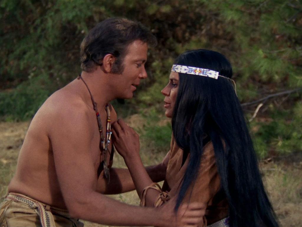 Shirtless Kirk and Miramanee embrace