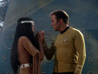 Miramanee holds Kirk's hands on the obelisk
