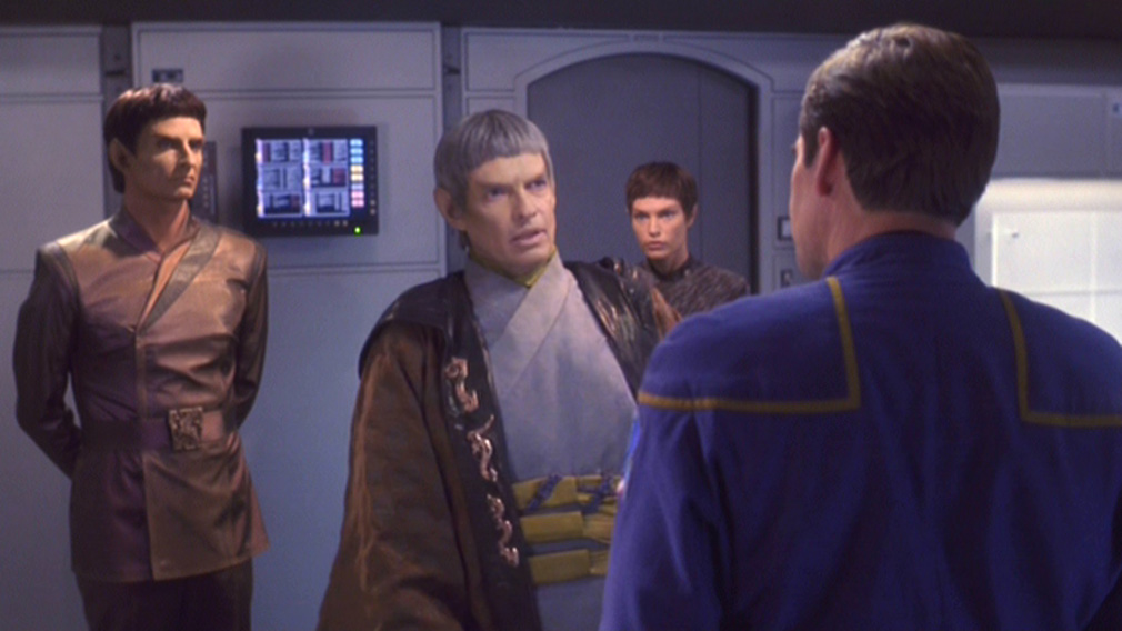Soval and an aide talk to Archer as T'Pol looks on