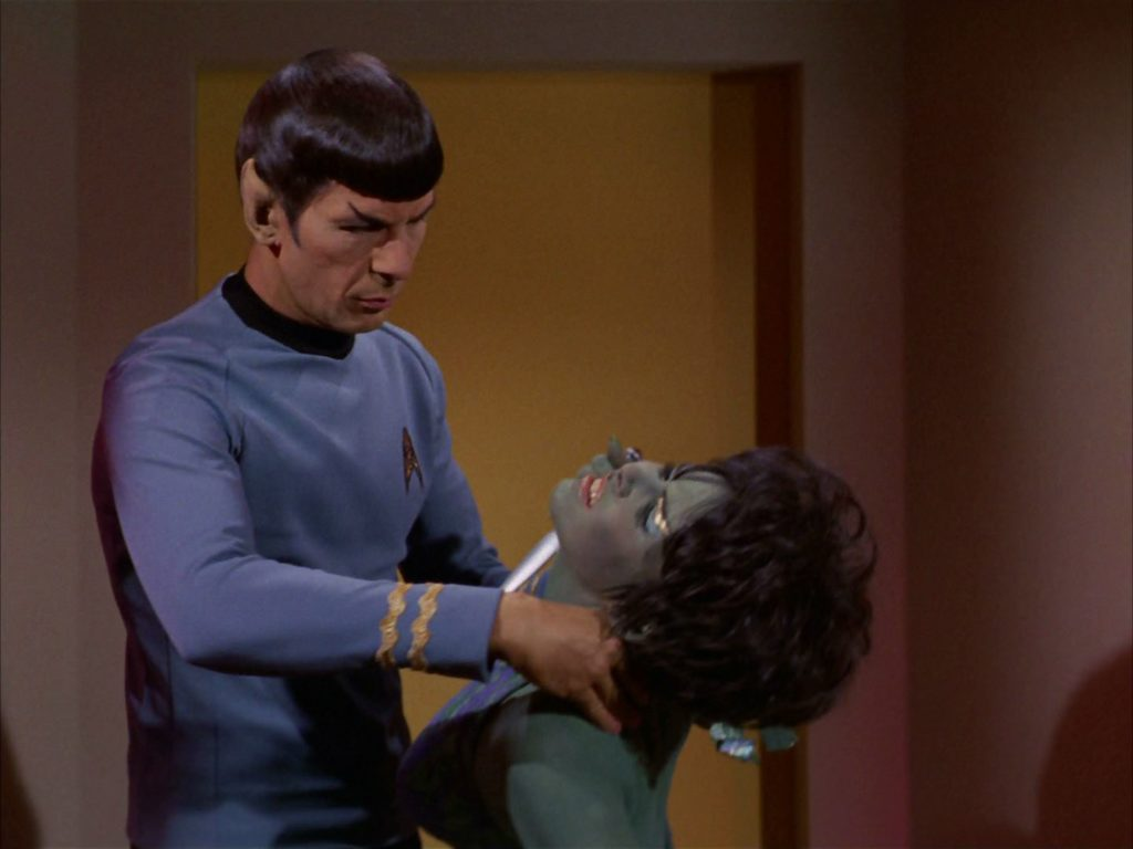 Spock subdues Marta with a neck pinch