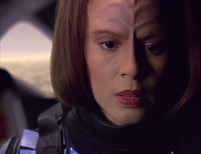 B'Elanna prepares to jump out of the back of a shuttlecraft on the holodeck