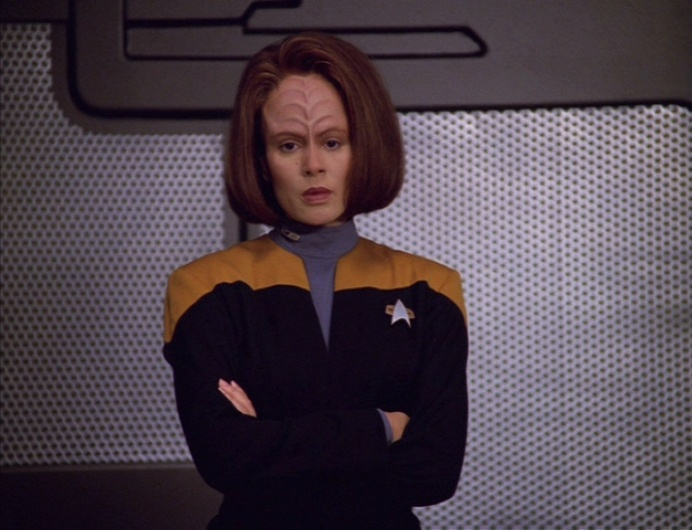 B'Elanna stands staring vacantly in the cargo bay