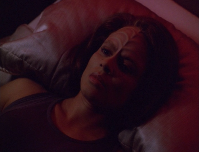 B'Elanna in bed, staring at the ceiling