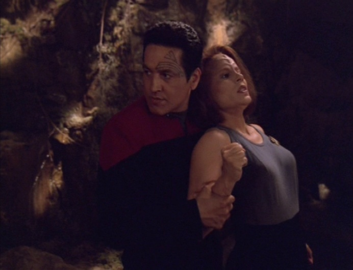 Chakotay physically pulls B'Elanna into her holodeck simulation, as she resists
