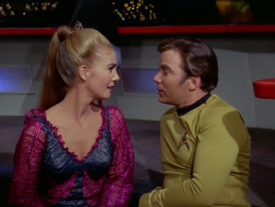 Kirk and Odonna make eyes at each other on the bridge