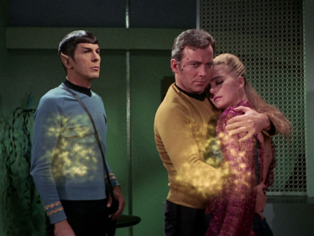 Spock, Kirk and Odona beam up to the ship
