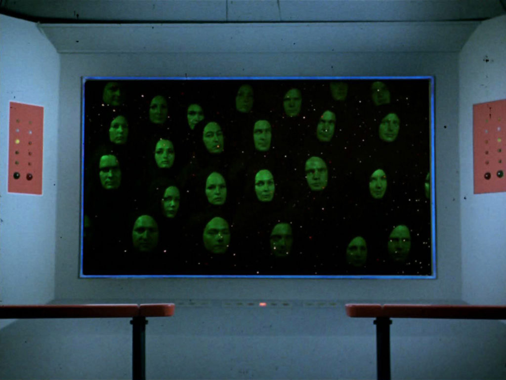 Floating green heads on the viewscreen